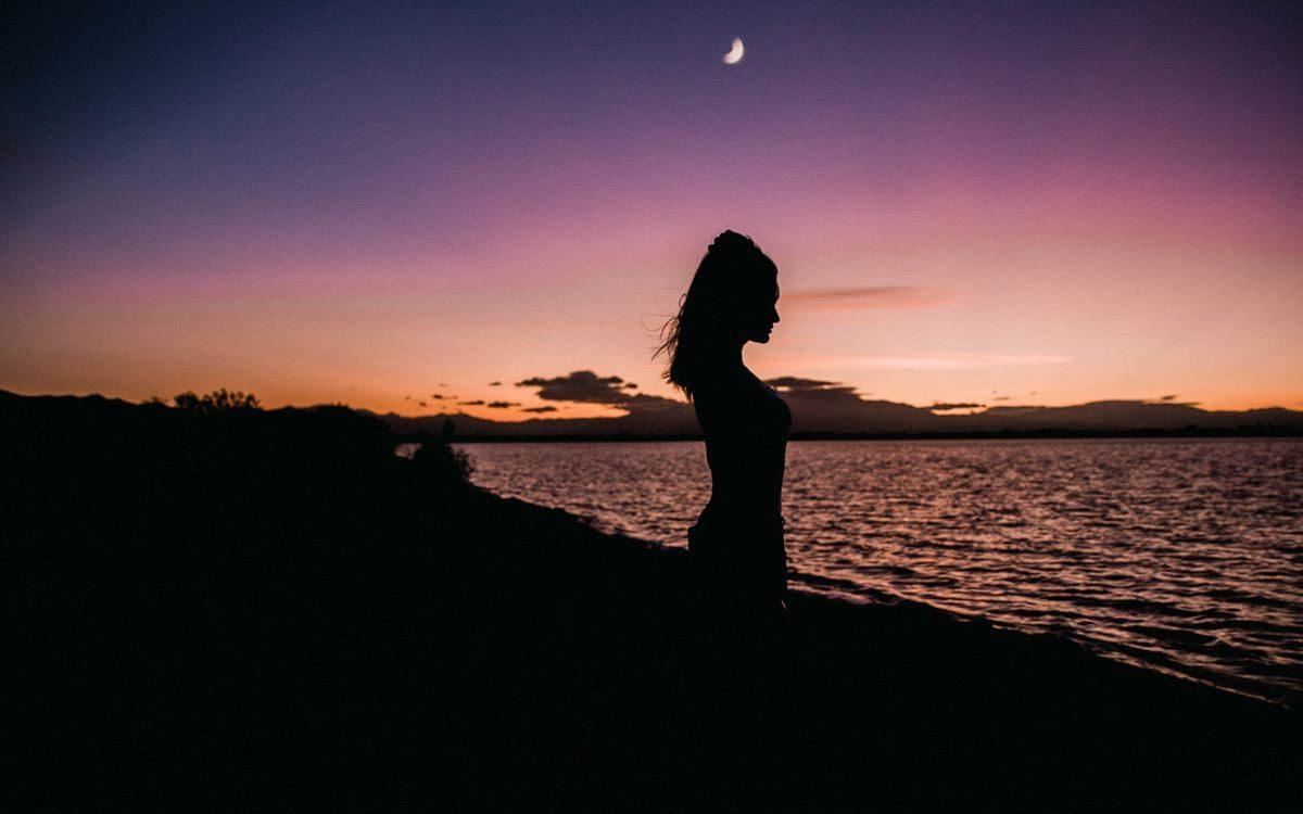 woman on beach under the moon